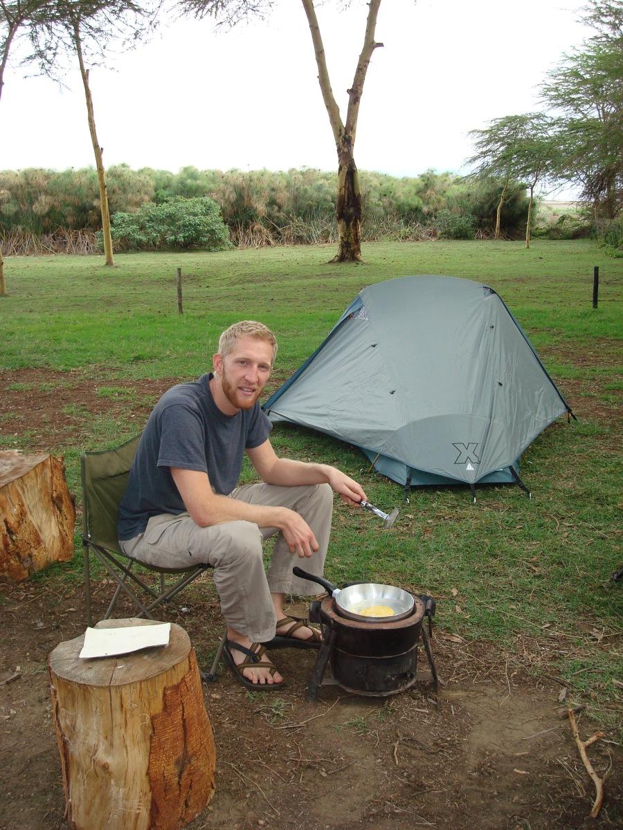 Jamie cooking pancakes over the Jiko...
