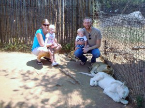 With the lion cubs...