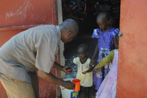Pastor M serving the children at the feeding program in Lokichoggio....This is one of the three projects supported by the Northern Kenya Feeding Program,