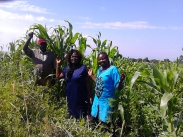 Gladys and Alice of Christian Ministries to the Destitute in Nakuru (home to 150 children) on the 5 acres of land where we will be planting maize and beans for the feeding program as well as income.