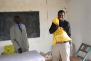 Joe receiving a large bag of maize...