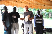 Visiting rural Kenya always brings gifts of appreciation. In Rangwe, we were blessed with a freshly cut stalk of bananas, a bag of hand roasted groundnuts (peanuts), 30 eggs, 2 large sacks of maize, and 2 live chickens. These were exceedingly generous people.